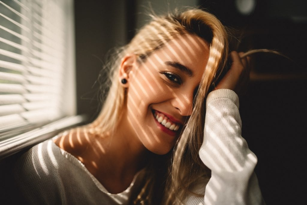 Woman happy and fully recovered after rhinoplasty